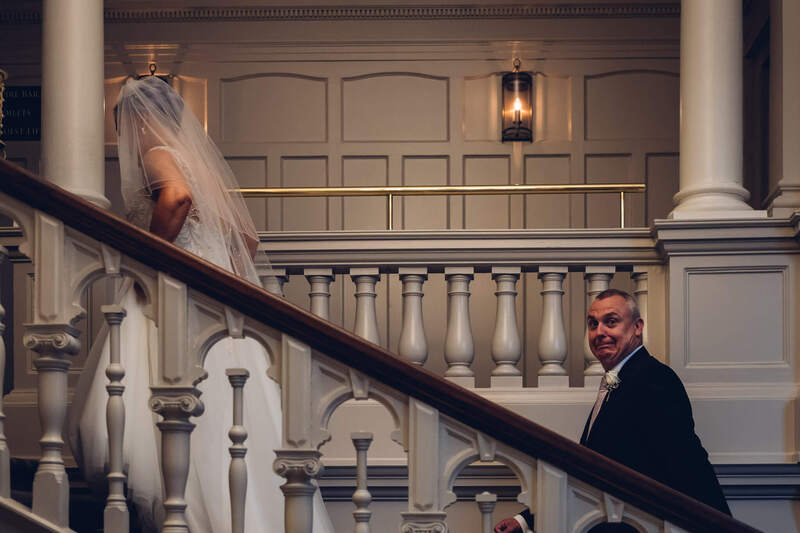 Bride and Groom head upstairs after their civil ceremony wedding at Bishops Gate Hotel Derry