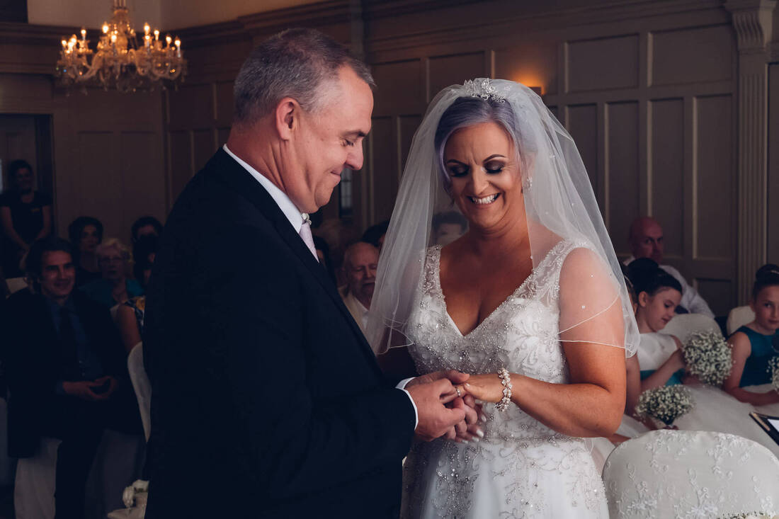 A candid, natural wedding photograph of Grainne and Andy during their Wedding Civil Ceremony at Bishops Gate Hotel Derry by Patrick Duddy Documentary Wedding Photography