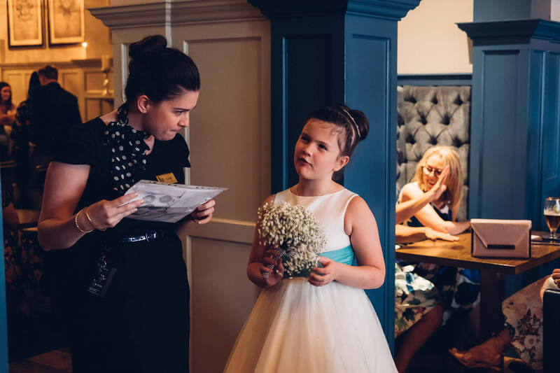 A young flowergirl ponders her dinner choices at Bishops Gate Hotel, Derry