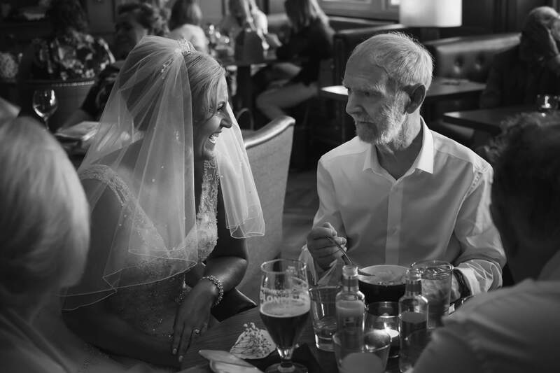 The bride shares a moment with her father during the afternoon of the wedding at Bishops Gate Hotel Derry