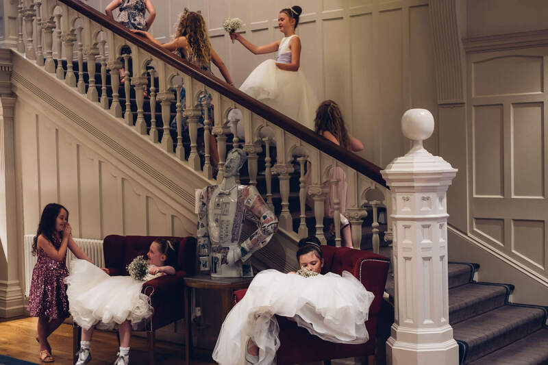 Flower Girls adorn the staircase of Bishops Gate Hotel, Derry during the wedding day.
