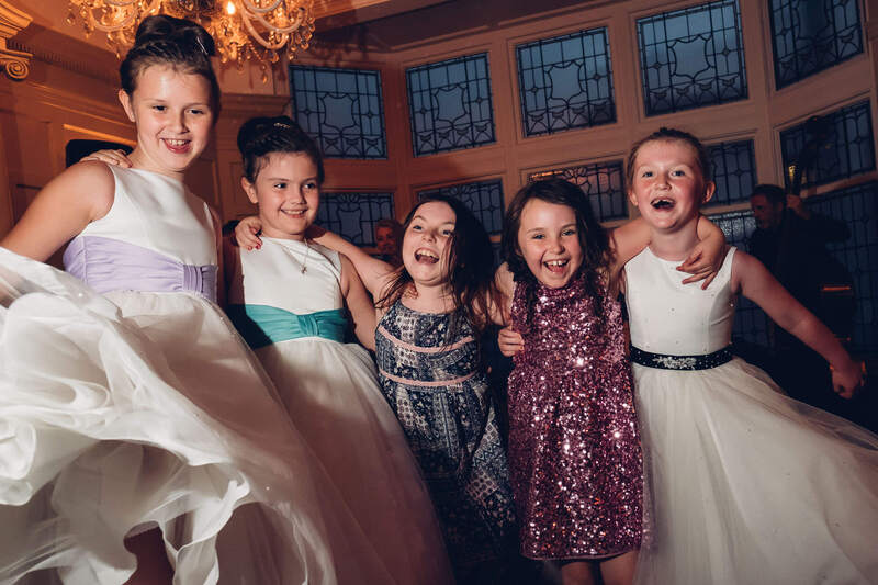 Young Bridesmaid dancing the night away in Bishops Gate Hotel. Derry