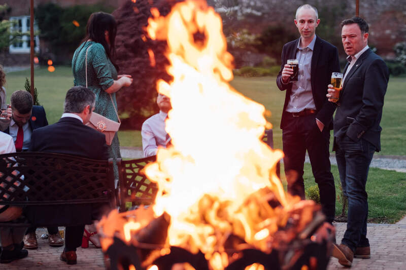 And it burns burns burns... wedding guests watch on as the fire pit in Ballyscullion Park Wedding Venue lights up the evening