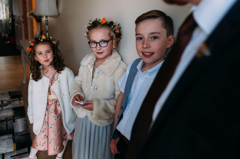 Flowergirl gather waiting for their first look at the Bride before heading off to the Bishops Gate Hotel to enjoy the wedding