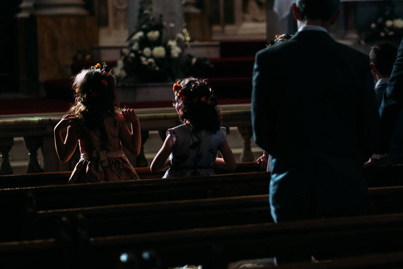 Flower Girls In Long Tower Chapel, Derry, during the wedding ceremony.