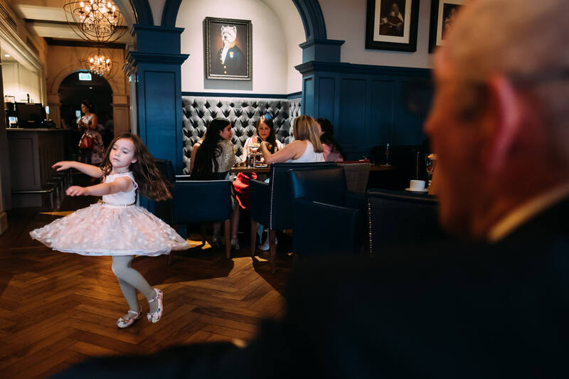 Young girl dancing in Bishops Gate Hotel during the wedding day