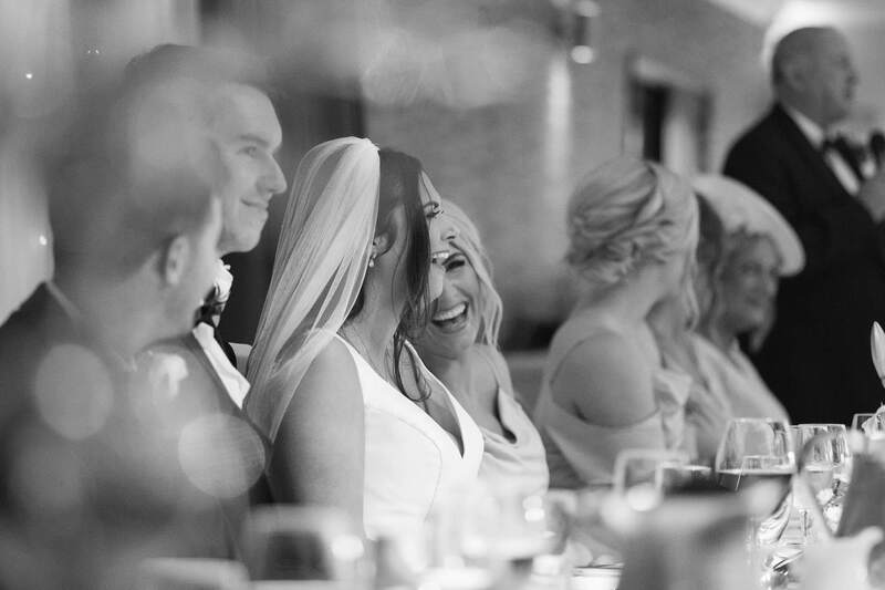 The Bride and Bridesmaid laugh during the Father of the Bride's speech Harvey's Point Hotel, County Donegal.
