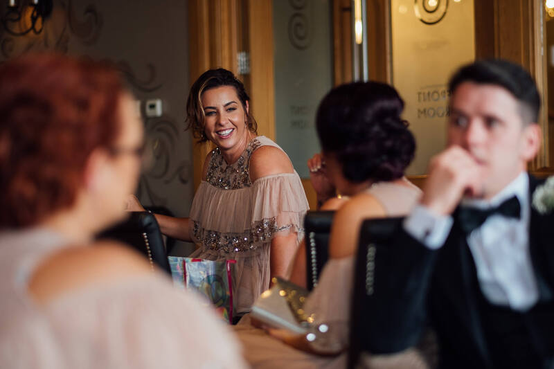 Bridesmaid chat naturally prior to the wedding breakfast at Ballyliffin Lodge Hotel