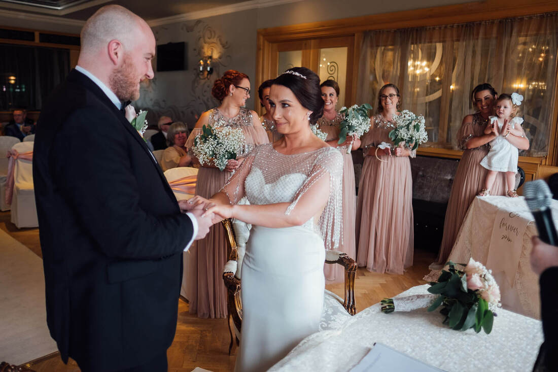 A natural and candid wedding photograph of Paddy & Nadine during their wedding - civil ceremony at Ballyliffin Lodge Hotel, County Donegal, Ireland by Patrick Duddy Wedding Photography based in Derry, Northern Ireland