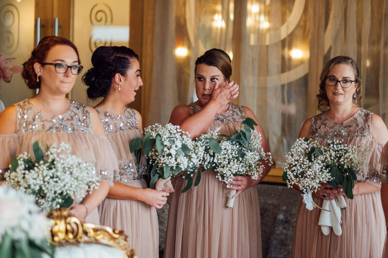 Belfast bridesmaids share's a laugh and a tear during the civil ceremony of Paddy & Nadine in The Ballyliffin Lodge Hotel, Country Donegal, Ireland.