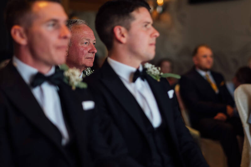 Father of the Groom holds back the tears as the bride and groom exchange their wedding vows at the Ballyliffin Lodge Hotel, County Donegal.