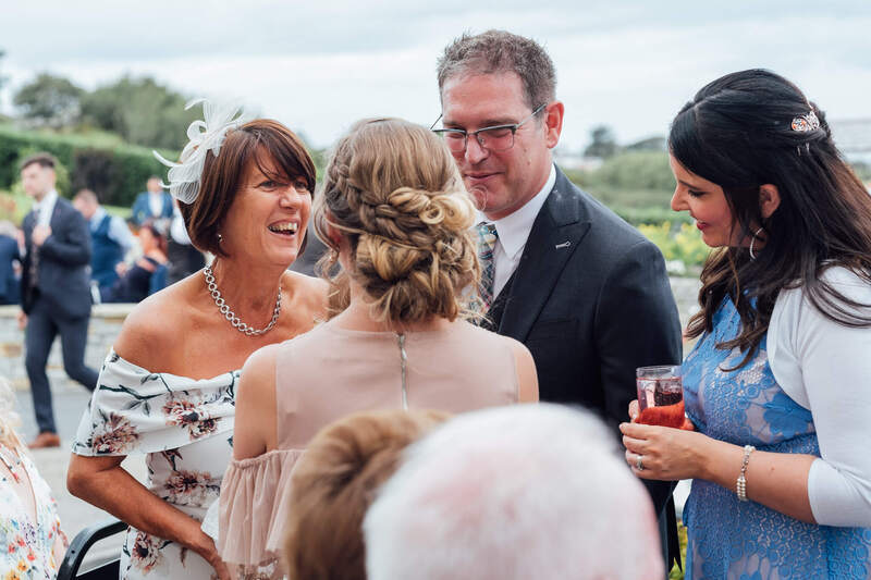 Wedding guests chat and laugh while enjoying the Donegal Sunshine at the Ballyliffin Hotel, Country Donegal