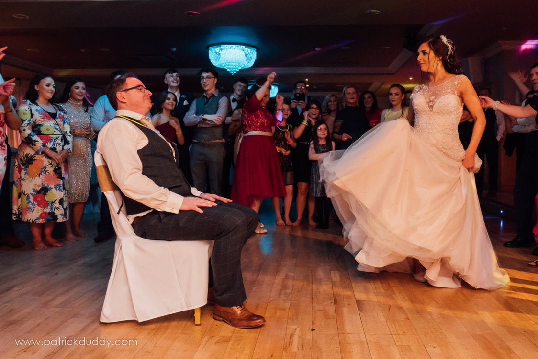 Eileen & Paul on the dance floor after their St Finlough's, Ballykelly wedding during their reception at Ballyliffin Lodge, County Donegal, Ireland by Patrick Duddy Documentary Wedding Photography, Derry, Northern Ireland.
