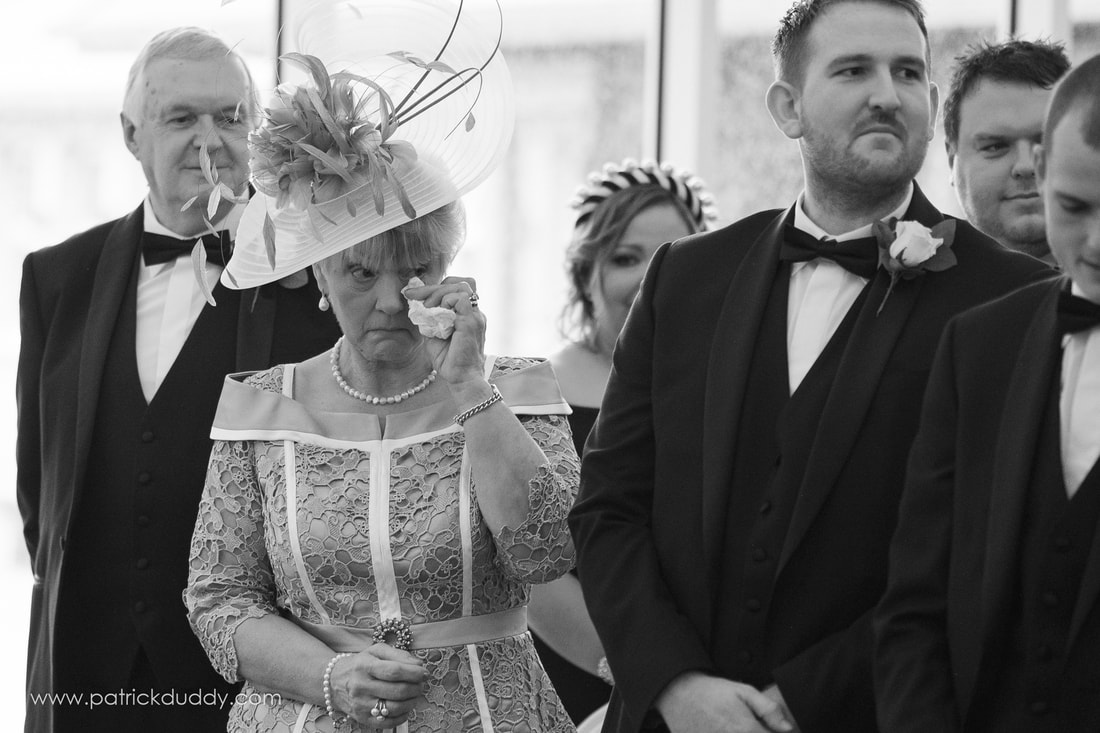 Mother of the Groom watches on as Bride & Groom begin their Wedding at Harveys Point