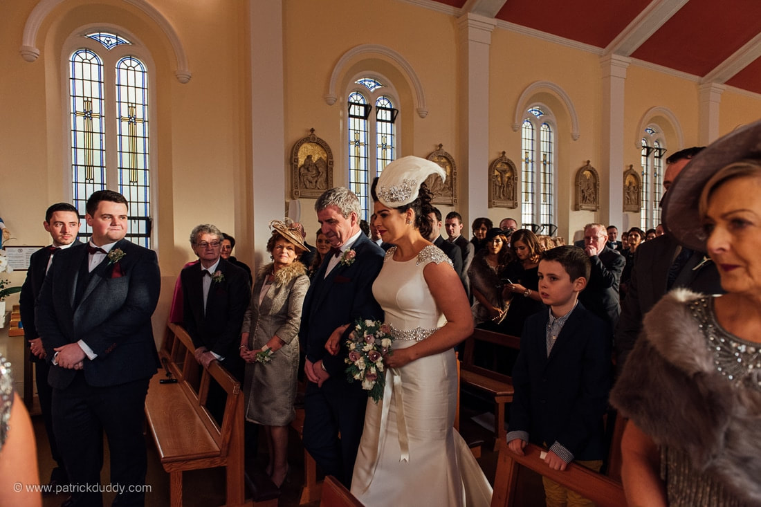 Sonya & William meet at the top of the aisle in the Church of Ease, Fahan & Silver Tassie Hotel Wedding, Country Donegal, Ireland. The reportage style photograph was taken by Patrick Duddy Doucmentary Wedding Photography, Derry, Northern Ireland.